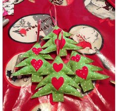 Large handmade shabby chic Christmas decorations pine tree made with green dotty material and remnant red material stuffed with wodding and hung with pretty ribbon