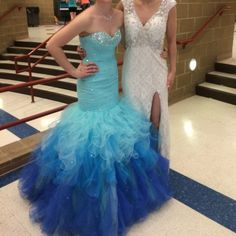 Prom Dress for sale Prom Dress Size 4. Aqua blue ombré mermaid dress. Corset back with zipper over the butt. Jewels on the skirt and all up the top. It's never been altered. Bought in a professional dress shop in Wilmont South Dakota. Very full skirt. I am 5'6 and I wore flats. Dresses Strapless