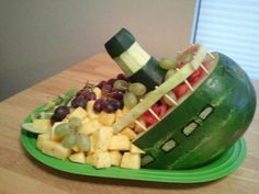I made this for my Titanic Party. Just carved the watermelon and used a zucchini for the smoke stack.