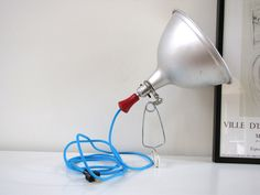 Reserved for Janet - Vintage Clamp Lamp with Blue Fabric Cord. $125.00, via Etsy.