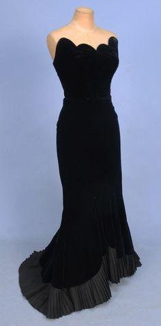 Black velvet strapless 1950s evening gown with scalloped neckline