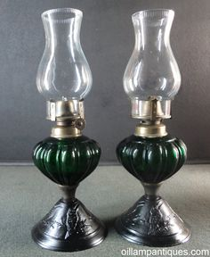 This pair of tiny Lithgow Lamps have cast iron bases and dark emerald green glass fonts. The cast iron bases are embossed all around with Kookaburras. Antique Oil Lamps, Vintage Lamps, Kerosene Lamp, Beautiful Interior Design, Cabin Ideas, Working Area, Ruby Red, Table Lamps, Emerald Green
