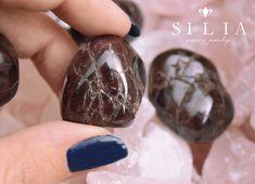 Garnet Tumble stone on Rose Quartz background Tumbled Stones, Gems Jewelry, Gem S, Crystal Healing, Rose Quartz, Garnet, Rings For Men, Gemstones, Sweet