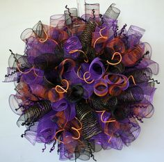Wreath created by Lori Howard Of DyJo Designs https://www.etsy.com/shop/DyJoDesigns This customer favorite, two years running, is a 32 inch Halloween spiral mesh wreath featuring black, purple, and orange. The black, purple, and orange plaid poly deco mesh and the glitzy sticks were purchased at http://www.trendytree.com. #trendytree #halloween