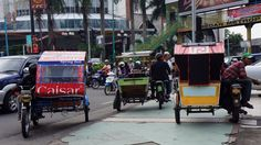 The busy city: A motorized pedicab might be a good option to handle the city's traffic and laneways. (Photo by Edna Tarigan)