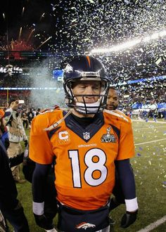EAST RUTHERFORD, NJ - FEBRUARY 02: Quarterback Peyton Manning #18 of the Denver Broncos walks off the field after their 43-8 loss to the Seattle Seahawks during Super Bowl XLVIII at MetLife Stadium on February 2, 2014 in East Rutherford, New Jersey. (Photo by Kevin C. Cox/Getty Images) Denver Broncos Football, Football Love, Seattle Seahawks, Football Helmets, East Rutherford, Metlife Stadium, Have Good Day, Peyton Manning, Pro Cycling