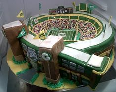 Storied Lambeau Field recreated in fondant and chocolate cake in honor of the Green Bay Packers Fans - What a wedding Cake!  #footballwedding