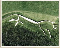 The Uffington White Horse,Uffington, Oxfordshire, England - UK  Created: c. 1000 BC  Length: 105.5m / Width: 29.5m / Trench Depth: 92cm .Carving in turf to reveal underlying chalk with additional trenches