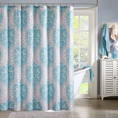 Lilly is the perfect way to make a fashion statement in your bathroom. The vibrant aqua and grey damask print adds a pop of color to this shower curtain.