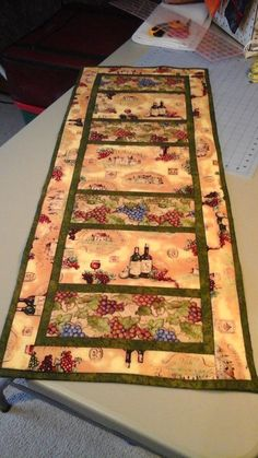 Machine quilted wine themed table runner by DebsAccents on Etsy