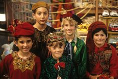 The Santa Clause: Elves - love their costumes, the rich fabrics, the ribbons and the hats. These elf costumes are not the stereotypical red & green felt/fabric. Disney Films, Disney Pixar, Disney Live, Santa Claus Movie, Santa Clause, Tim Movie, Christmas Elf Costume, Childhood Movies, Warm Fuzzies
