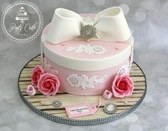 Vintage Bow Hatbox Birthday Cake With Roses And Swarovski Crystals. - http://pontycarlocakes.com/vintage-bow-hatbox-birthday-cake-with-roses-and-swarovski-crystals/ #Birthdaycake, #Bling, #Brooch, #Cake, #Crystals, #Ganache, #Lace, #Pink, #Pontycarlocakes, #Rose, #Rosebuds, #Sharpedge, #Swarovski, #Vintage