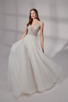 Sparkle as you walk down the aisle in this dazzling ball gown wedding dress! Featuring beaded embroidered appliqués creating a leaf motif that embellish the bodice and trickle onto the soft tulle skirt. The illusion bodice features a deep V-neckline, V-back, and slimming cummerbund at the waist! Follow this link to view more style 99183! Bridal Dresses, Wedding Gowns, Flower Girl Dresses, Wedding Bells, Tulle Ball Gown, Ball Gowns, Justin Alexander Signature, Justin Alexander Bridal, Glamour
