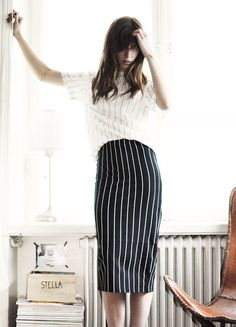 Black and white stripes on stripes.  White button down short sleeve shirt with black stripes tucked into high waist black pencil skirt with white stripes.