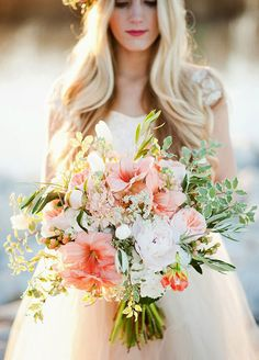 Calling all boho brides, this loose arrangement of beautiful blooms is just the…