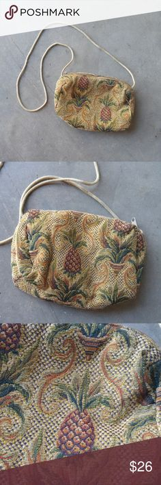 A La Main Pineapple Print Purse A La Main brand purse in excellent condition! Tan and brown pineapple print with black lining. Zipper on top and thin shoulder strap. No visible signs of wear to bag, some minor wear to strap. No trades. No modeling. Make a reasonable offer. Thanks! A La Main Bags Shoulder Bags
