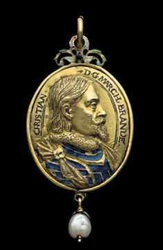 Gold pendant, on one side the medallic portrait bust of Christian, Margrave of Brandenburg-Bayreuth (1581-1655) inscribed CHRISTIAN DG MARCH BRANDE, the back with another of his wife, Maria of Prussia (1579-1649) inscribed MARIA DG MARCH BRANDE, both facing in profile towards the right, details of dress enameled in colours, surmounted by blue, green and white scrollwork with suspension loop, hanging pearl below. German, Christian Maler, c.1610.