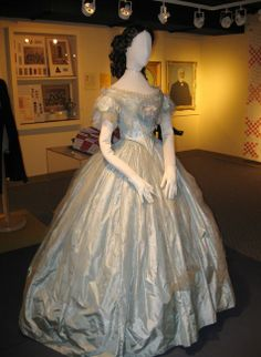 Blue dress that caught the eye of Prince of Wales goes on display in St Thomas Ontario. Light blue, with silk and a rose. 1860