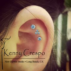 Neometal in a triple flat piercing by Kenny Crespo at New Flower. This is where the best piercing in Long Beach comes from.