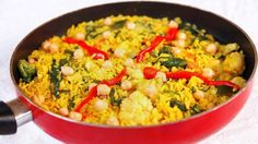 Some time ago I visited Spain. What I didn't anticipate was the delicious food. I of course went straight for the manchego cheese and tapas before moving on to bigger main course dishes. It was the paella that stopped me dead in my tracks and made me a firm lover of the Spanish food culture. This is my vegetable version of paella, honoring my first trip to Spain. This dish is loaded with various vegetables and a handful of chickpeas. Delicious!