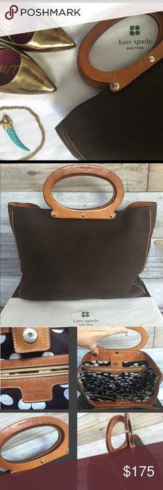 {Kate Spade} RARE Canvas Tote with Wood Handles RARE, amazing (vtg?) Kate Spade Canvas Tote--PRISTINE condition...bag is rich chocolate brown, thick double lined canvas piped throughout in camel leather. Four feet in perfect condition...I'd say this bag was likely never carried--only handled. Not a spot anywhere...Round leather-wrapped wood handles w/ Kate Spade Stamp--any mottling in handle leather is naturally occurring & is not wear. Gold hardware--all grommets & feet perfect/unscratched…