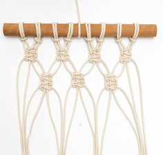 DIY mini macrame wall hanging: group together original 4 cords to create the next row.