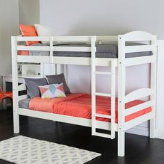 This solid wood twin over twin bunk bed, with its stylish contemporary design and attractive white finish, is a perfect addition for any room. The all-wood construction provides long-lasting durabilit