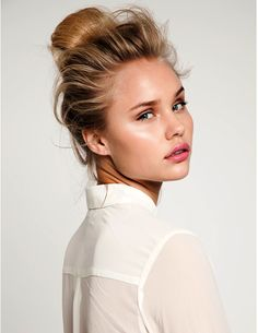 dewy makeup and windswept bun