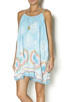 Look a total island girl in this gorgeous tropical print shift dress with skinny adjustable straps and turquoise pom pom hem detailing. Unlined. This dress is very generously sized! In a soft rayon fabric with pom pom detail trim, this swing dress will give you an easy to wear dress perfect for hot summer days or even cheeky summer nights.   Beachy Pom Shift by Twist. Clothing - Dresses - Printed Clothing - Dresses - Casual Clothing - Dresses - Mini Santa Monica, Los Angeles, California