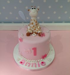 Sophie Giraffe themed birthday cake www.vintagehousebakery.co.uk