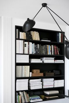 recessed black shelves + stacks of magazines