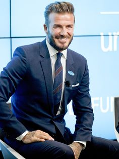 Star Tracks: Tuesday, February 10, 2015 | GOOD AS IT GETS | Goodwill never looked this good! David Beckham flashes a smile in London on Monday while speaking at a press conference marking his 10th year as a UNICEF goodwill ambassador. David Beckham Style, David Beckham Unicef, Dapper Gentleman, Gentleman Style, Sharp Dressed Man, Well Dressed Men, Tweed Sport Coat, Bend It Like Beckham, Moda Formal