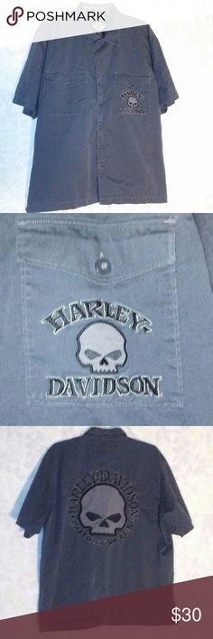 Harley-Davidson button up shirt Darkish gray shirt with a skull with that says Harley-Davidson on the front pocket and the back center of the shirt. Harley-Davidson Shirts Casual Button Down Shirts