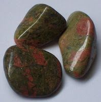"Unakite    Unakite is said to lift your spirits when you are feeling down. It is also used to uncover deception. Unakite is also called Epidote, from Greek 'epidosis', meaning ""growing together"". It is red jasper and green epidote naturally bound together."