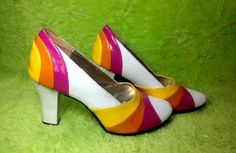 Pink, orange, yellow. Wild color combination! You know these would look smashing with a 60s mini dress. The shoes are made of vinyl and fake