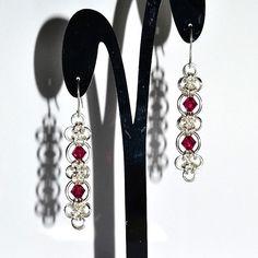 Juliet Earrings with Swarovski Crystal Elements in ruby. #jewellerydesign #madeinscotland #earrings #handmadejewellery #design #fashion #MindarlaDesign #swarovskicrystals