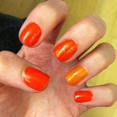 OPI's A Roll in the Hague and Osaka-to-Me Orange, with Essie Luxe Effects on the two accent nails