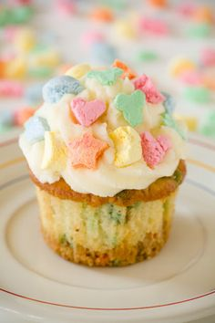Lucky Charms cupcakes feature a triple dose of luck: a Lucky Charms crust, Lucky Charms mixed into the cupcake batter, and Lucky Charms marshmallows on the frosting