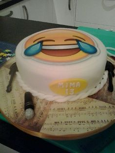 Girls 13th Emoji/Musical themed Birthday Cake. Board covered in Rice paper, sepia coloured Musical notes.