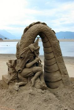 Cool looking sculpture of a sand dragon eating a boy and his sand castle. Snow Sculptures, Sculpture Art, Street Art, Snow Art, Dragon Art, Sea Dragon, Beach Fun, Summer Beach, Beach Kids
