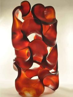 Abstract glass sculpture. Contemporary Pollitt studio glass art in-the-round. Sweeping lines, dramatic negative space, sensual movement. Available online.