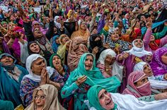Kashmir Kashmiri Muslim women pray as a holy relic believed to be the whisker from the beard of the Prophet Mohammed is displayed during the Muslim festival Mehraj-u-Alam