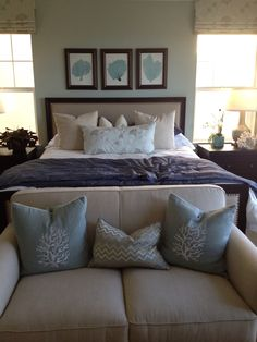 Beach Bedroom!: love the framed art & comfy seating -- symmetry of pillows and framed art----love the couch at the end of the bed