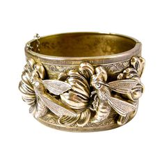 Vintage Heavily Carved Bumble Bee Flower Bracelet | From a unique collection of vintage retro bracelets at https://www.1stdibs.com/jewelry/bracelets/retro-bracelets/