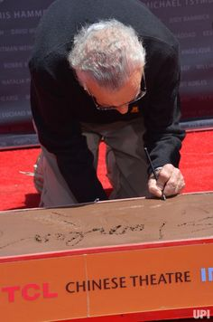 Marvel comic book writer Stan Lee participates in a hand and footprint ceremony immortalizing him in the forecourt of TCL Chinese Theatre…