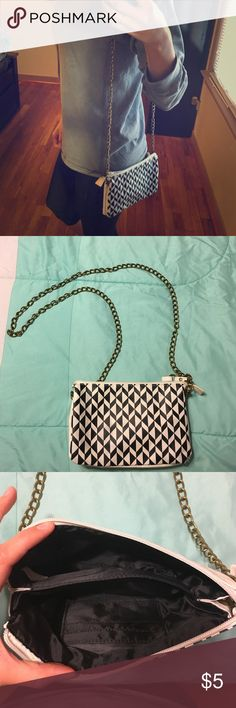 Black and white checkered purse 👛 Used a handful of times. Metal strap. Has some discoloration as pictured both front and back from rubbing against denim Jeans. Very clean on the inside. PacSun Bags Crossbody Bags