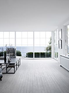 A designer's dream: an old summer cottage from 1926 redone with a modern twist and lots of stunning light, as well as breathtaking views. (Source: bloglovin.com via thedesignchaser.com.)