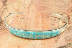 Turquoise Bracelet  Genuine Sleeping Beauty Turquoise inlaid between ribbons of Sterling Silver. Designed by Navajo Artist Calvin Begay.