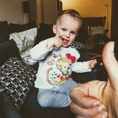 She's nailed the thumbs up. But she's also very fond of punching and shoving today.
