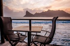 Beautiful sunset from the balcony of Tintswalo Atlantic overlooking Hout Bay in South Africa. One of the best and prettiest hotels ever...really.
